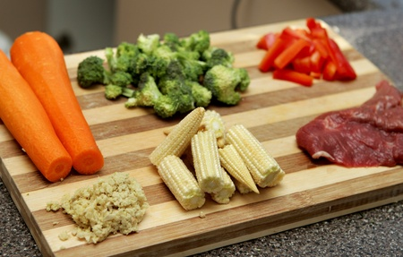 meal preparation: chopped and prepared stir fry ingredients including steak and vegetables