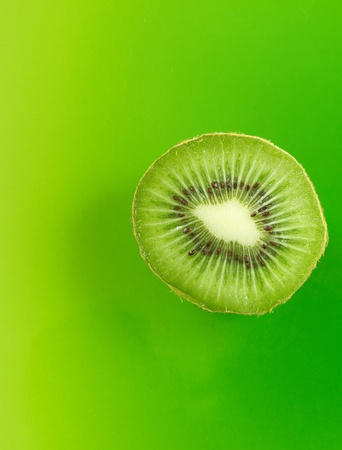 group of kiwi fruit slices covering a background
