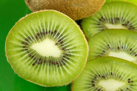 group of kiwi fruit slices covering a background Stock Photo - 12751316