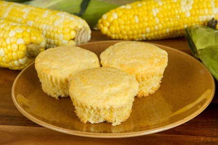 three fresh corn muffins with ingredients on a homestyle plate Banque d'images
