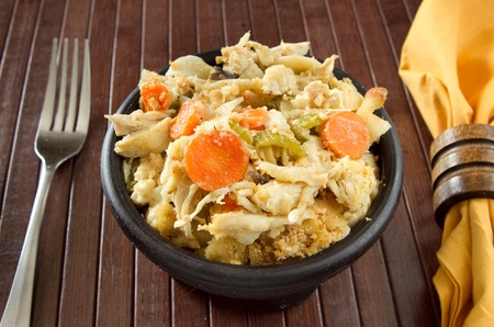 bowl of chicken noodle soup casserole with fork and napkin