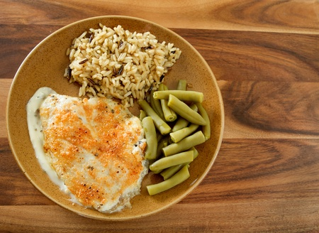 tilapia and parmesan sauce with rice and green beans meal