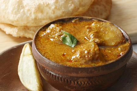 bengali: Alu Dum is  Bengali Spicy Potato curry  Alu dum contains Potatoes as a major ingredient and this can be served with Puri Luchi  roti and as a side for rice