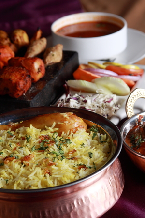 Hyderabadi Biryani - is perhaps the most well-known Non-Vegetarian culinary delights from the famous Hyderabad Cuisine . It is a traditional dish made using Basmati rice, goat meat and various other exotic spices  photo