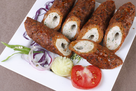 cuisines: Mixed Kebab refers to a variety of meat dishes in Indian and South Asian cuisines, consisting of grilled or broiled meats on a skewer or stick