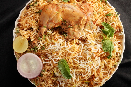 Hyderabadi Biryani - is perhaps the most well-known Non-Vegetarian culinary delights from the famous Hyderabad Cuisine  It is a traditional dish made using Basmati rice, goat meat and various other exotic spices  photo