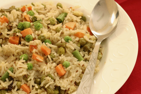indian cookery: Vegetable Biryani - A popular Indian veg dish made with vegetales and Basmati rice  Stock Photo
