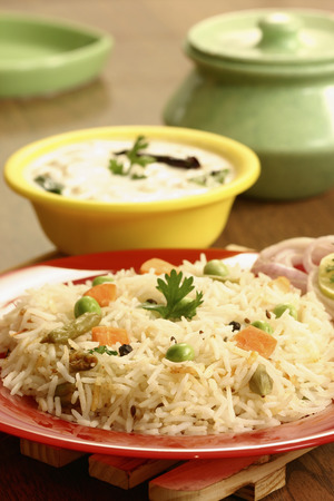 Vegetable Biryani - A popular Indian veg dish made with vegetales and Basmati rice  Stock Photo