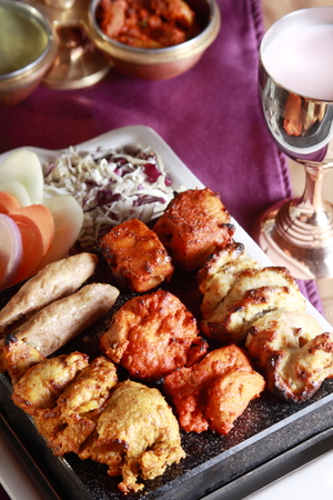 kabab: Kebab  or originally kabab is a wide variety of skewered meals originating in the Middle East and later on adopted in Turkey, Azerbaijan, Balkans, Spain, as well as Central and South Asia, that are now found worldwide