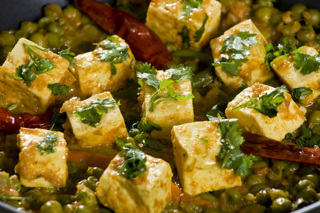 Mattar Paneer  is a north Indian dish consisting of Paneer,the Indian cottage cheese and peas in a slightly sweet  spicy sauce