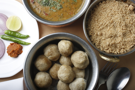 Churma - coarsely ground wheat crushed and cooked with ghee and sugar