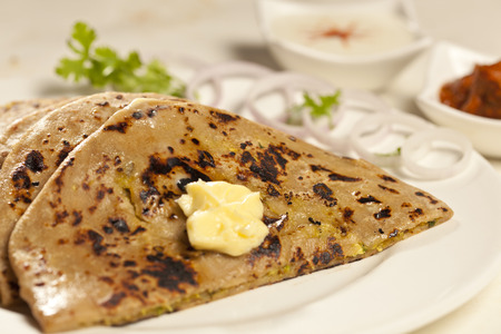 Hot delicious paratha with ghee  Stock fotó