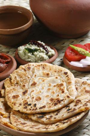 KA: Channa Dal Paratha - A flatbread made of stuffed boiled channa dal and spices