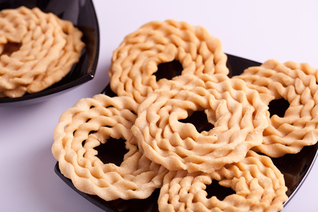 Murukku is a savoury snack popular in South India