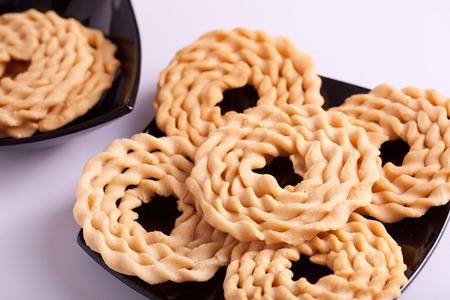 murkoo: Murukku is a savoury snack popular in South India