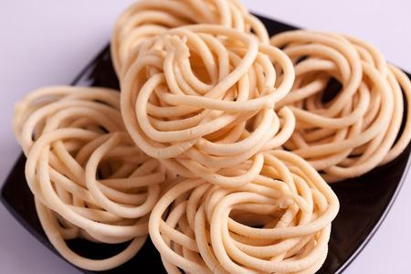 murukku: Murukku is a savoury snack popular in South India