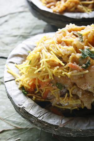 chaat: Aloo Tikki - A north Indian snack made of boiled potatoes and various spices  Found in almost every chaat shop or stall all over Delhi and other parts of India  It is served hot along with tamarind and green salsa and some times yogurt  Also with chick pe