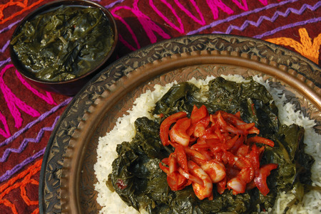 indian cookery: Haak Kashmir spinach made of spinach cooked in a mustard oil, yellow mustard seeds and fresh spices