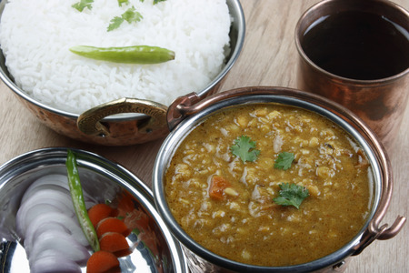 indian cookery: Mixed dal made of boiled lentils cooked with fresh Indian spices and tadka  tempering  of tomatoes, curd and butter