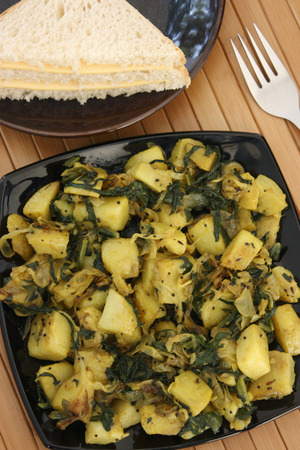 Spinach and potato cooked together  with tomato and green pepper Stock fotó