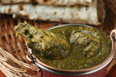 Saag Chicken it contains Chicken, cooked in Palak gravy  Spinach    with Indian spices  Served with roti  flat Indian bread  Stock fotó