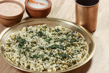 sprouted: Saag waali Khichri contains Rice cooked in Palak  Spinach ,Sprouted Beans and Indian spices  Served with pickle and curd