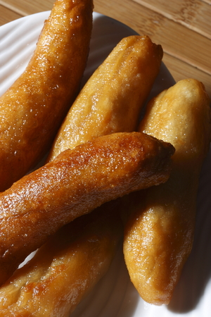 baking powder: Tosha contains maida  plain flour , curd, baking powder deep fried in oil and dip in sugar syrup Stock Photo