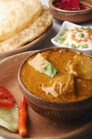 bengali: Alu Dum -  Bengali Spicy Potato curry  Stock Photo