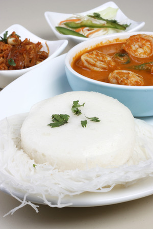 Idli - Steamed rice cakes from South India  photo