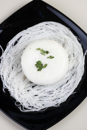 Idli - Steamed rice cakes from South India  Goan idli is made from dry yeast, coconut milk and sugar  photo