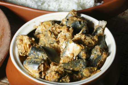 indian cookery: Fish varutharacha curry- a South Kerala style Fish Curry Stock Photo