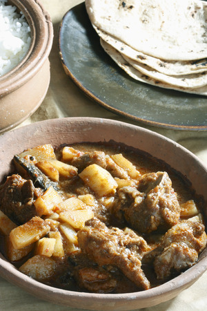 indian cookery: Tamil mutton vindaloo dish with rice, briyani, fried rice and for chappatis, paratas, idliy and Dosa  Stock Photo