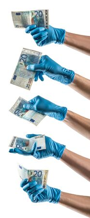 Some hands with blue latex glove holding a twenty euros bill