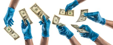 Some hands with blue latex glove holding a one dollar bill Foto de archivo