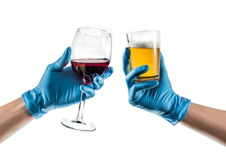Some hands with blue latex glove toasting with glass wine and glass beer
