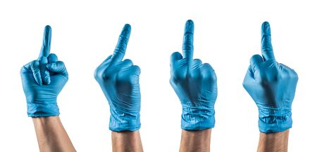 Some hands with blue latex glove showing the middle finger Foto de archivo