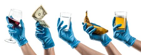 Some hands with blue latex glove holding everyday objects