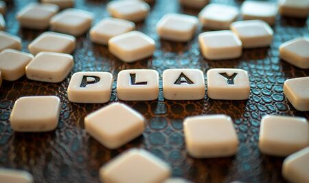 """Crossword game pieces forming the word """"Play"""""""