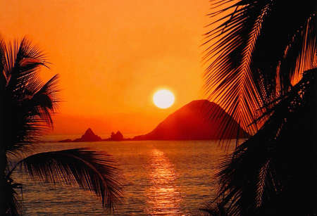 Beautiful Sunset at Iztapa Beach, Zihuatanejo, Mexico photo