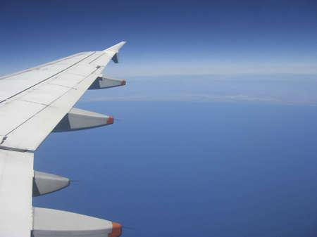Airplane Flying Over The Ocean Stok Fotoğraf