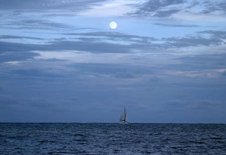 Blue Moon Over The Pacific Ocean Stock Photo