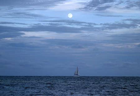 illuminated: Blue Moon Over The Pacific Ocean Stock Photo