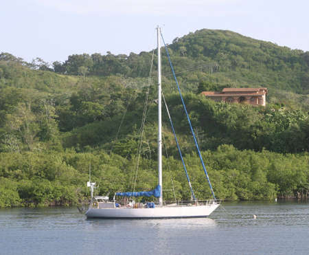 A villa and yacht in a pacific island