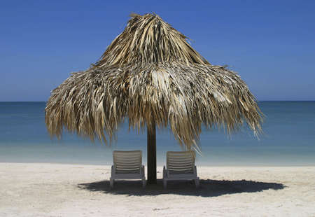 Two chairs and palapa in front of the ocean Stok Fotoğraf