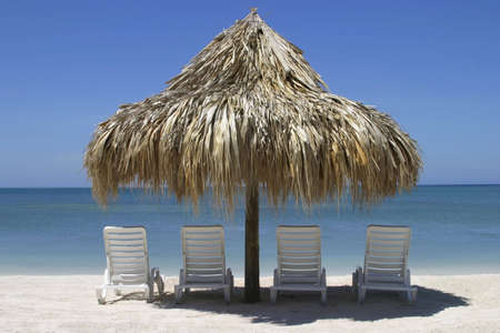 palapa: Four chairs and palapa in front of the ocean Stock Photo