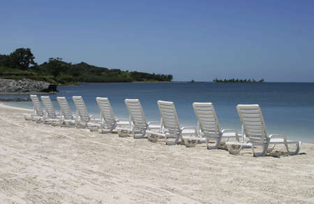 Row of chairs standing at the beach