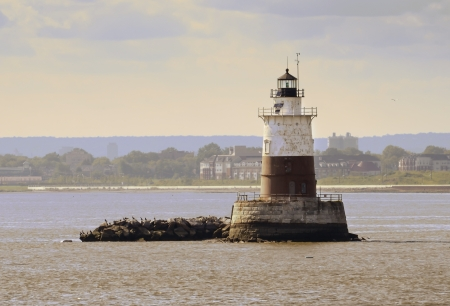 An old lighthouse lies in a small island in Manhattan Bay