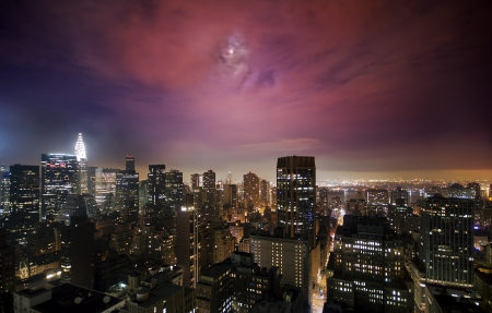 Illuminated skyscrapers under the moonlight in Manhattan Stock Photo