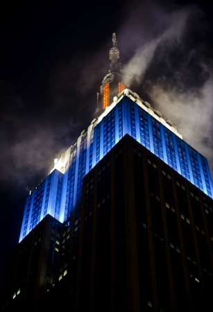 Top of Empire State Building in blue