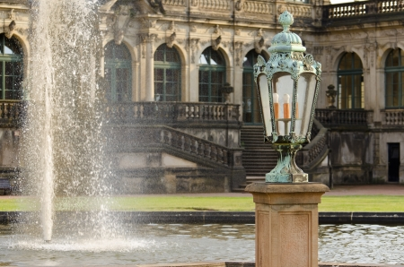 A Lamp next to the Fountain in the Zwinger, a Rococo Palace in the City of Dresden Editorial